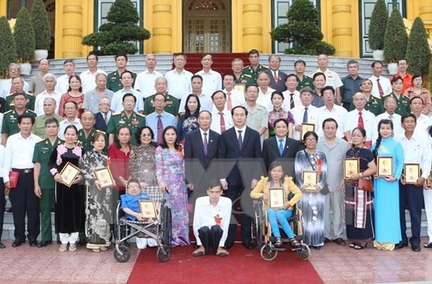Presidente exhorta a garantizar acceso de victimas de dioxina a politicas de apoyo hinh anh 1