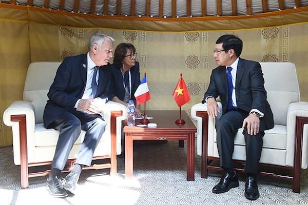 Viceprimer ministro vietnamita se reune con dirigentes de paises de ASEM hinh anh 1