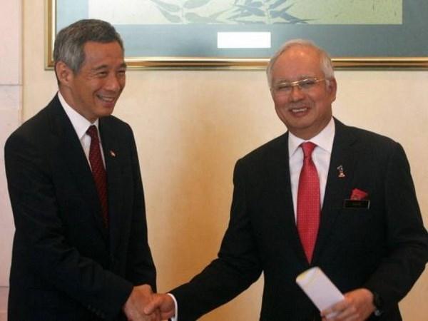 Firman Singapur y Malasia acuerdo sobre tren expreso hinh anh 1