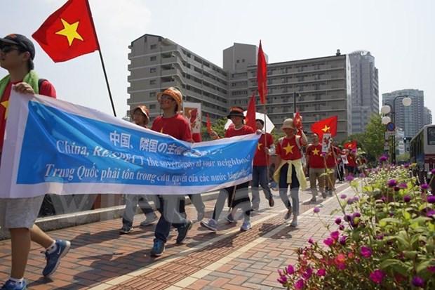 Marcha en Japon para exigir a China a cumplir con leyes internacionales hinh anh 1