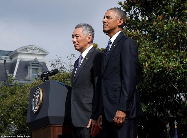EE.UU. y Singapur por fomentar cooperacion e impulsar TPP hinh anh 1