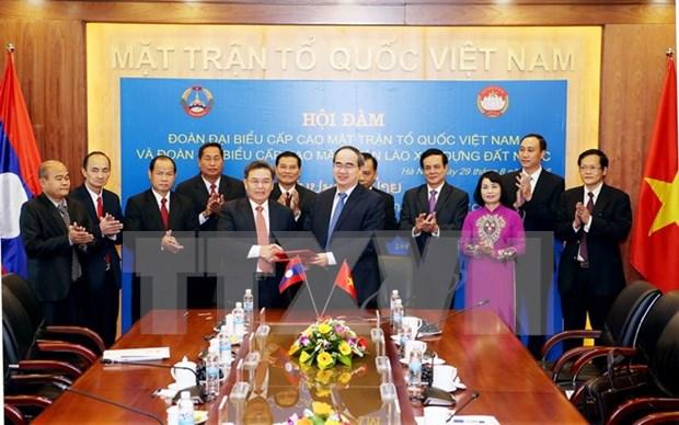 Organizaciones de masas de Vietnam y Laos robustecen cooperacion hinh anh 1