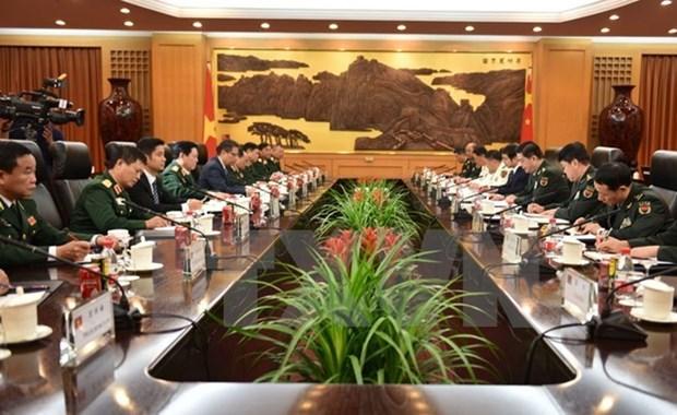 Acordaron Vietnam y China elevar eficiencia de cooperacion en defensa hinh anh 1