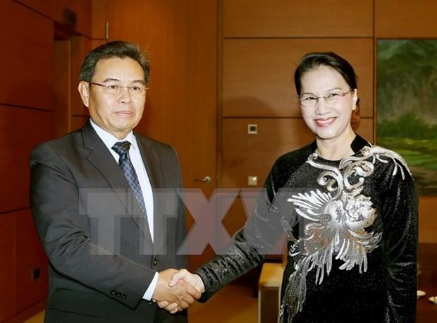 Lider parlamentaria de Vietnam recibe al jefe de organizacion de masas de Laos hinh anh 1