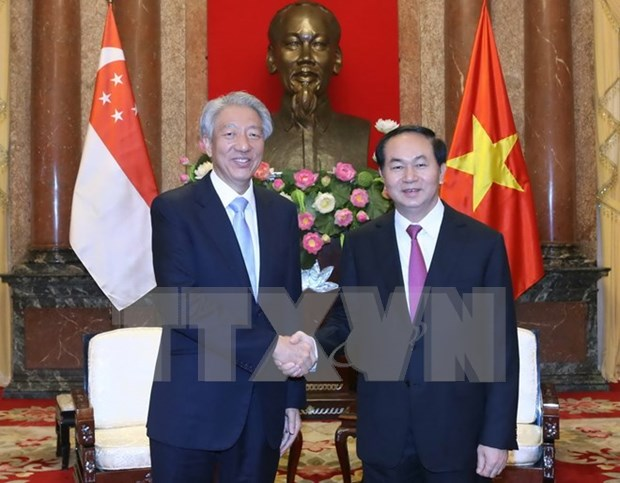 Presidente de Vietnam recaba inversion de Singapur hinh anh 1