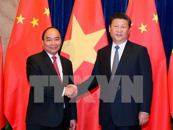 Primer ministro de Vietnam se reune con Xi Jinping hinh anh 1