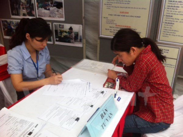 Victimas de dioxina en provincia vietnamita disfrutan de seguro medico gratuito hinh anh 1