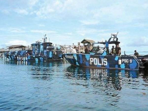 Otro ataque a barco y secuestro en aguas de Malasia hinh anh 1