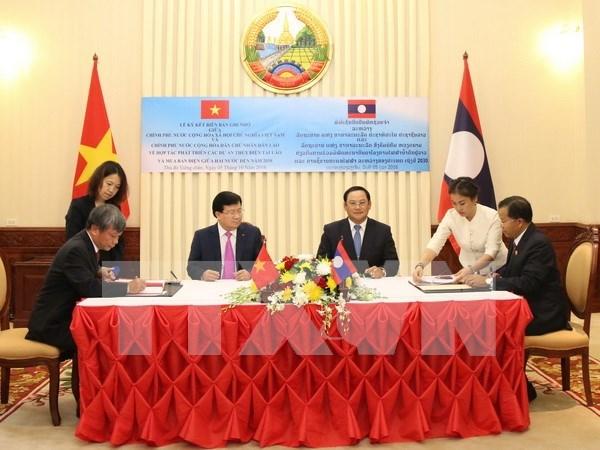 Firman Vietnam y Laos acuerdos de cooperacion hinh anh 1