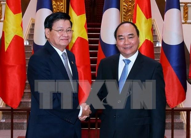 Vietnam y Laos estudian medidas para promover comercio bilateral hinh anh 1