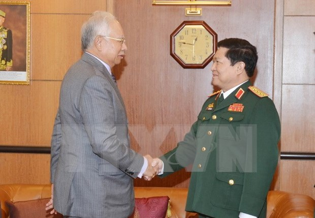 Cooperacion en defensa contribuye a asociacion estrategica Vietnam – Malasia hinh anh 1