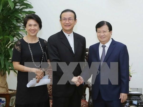 Viceprimer ministro de Vietnam recibe a ejecutivo del Grupo tailandes Amata hinh anh 1