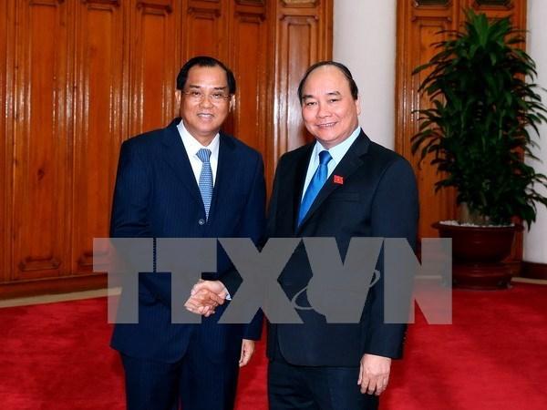 Premier vietnamita exhorta a Laos a facilitar actividades de empresas hinh anh 1