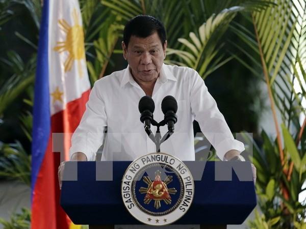 Presidente de Filipinas visita Malasia hinh anh 1