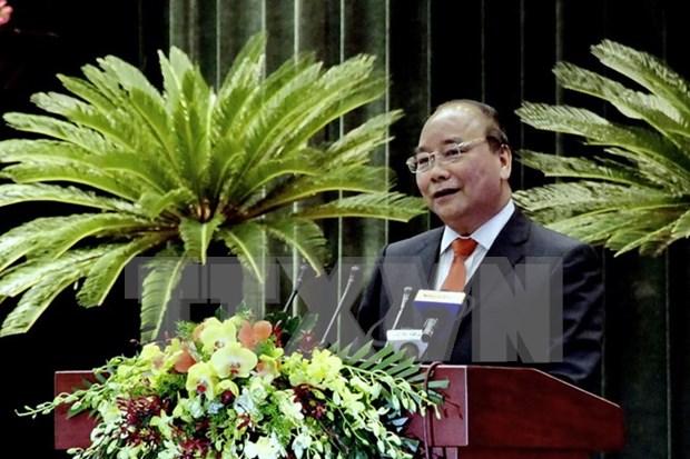 Primer ministro vietnamita dialoga con expertos connacionales en Ultramar hinh anh 1
