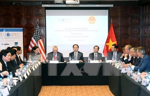 Presidente de Vietnam continua agenda ocupada al margen del APEC hinh anh 1