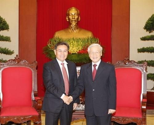 Lider partidista de Vietnam se reune con jefe de organizacion de masas de Laos hinh anh 1