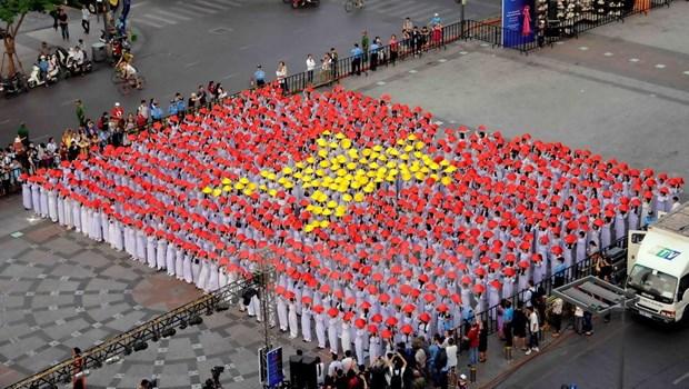 [Galeria] Miles de estudiantes desfilan con Ao Dai en Ciudad Ho Chi Minh hinh anh 2