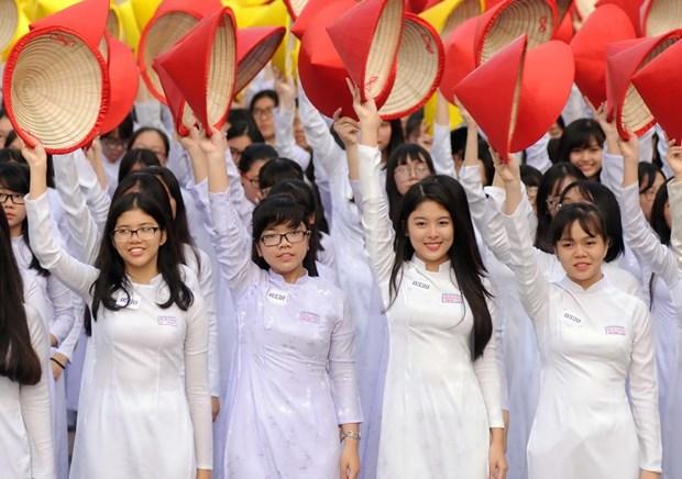 [Galeria] Miles de estudiantes desfilan con Ao Dai en Ciudad Ho Chi Minh hinh anh 4