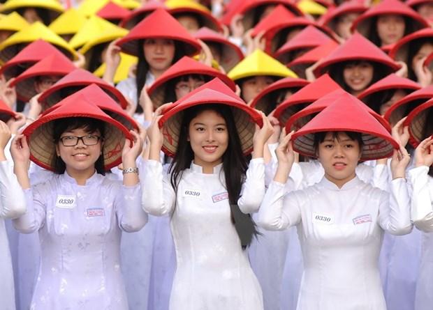 [Galeria] Miles de estudiantes desfilan con Ao Dai en Ciudad Ho Chi Minh hinh anh 5