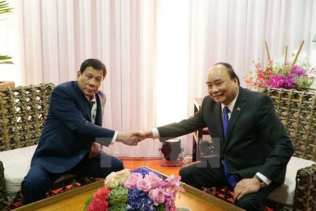 [Fotos] Actividades de premier Xuan Phuc en Manila hinh anh 7