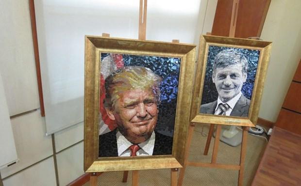 Cierra sus puertas en Hanoi exposicion de retratos de lideres del APEC hinh anh 1