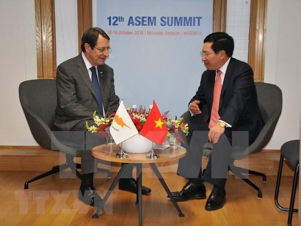 Vicepremier y canciller de Vietnam continua con agenda apretada al margen de ASEM hinh anh 1