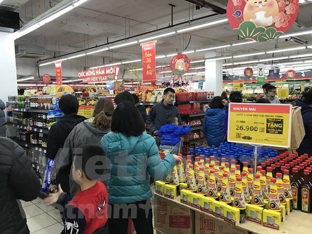 Almacenan empresas vietnamitas bienes esenciales ante impactos de nuevo coronavirus hinh anh 1