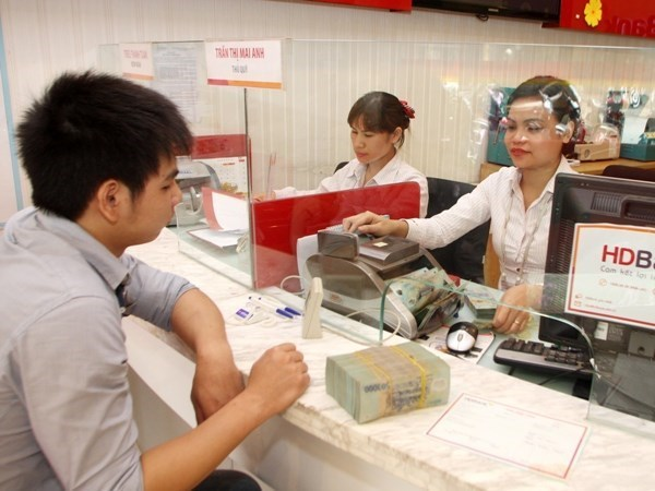 Sector bancario de Vietnam por respaldar a comunidad empresarial ante impactos de COVID-19 hinh anh 1