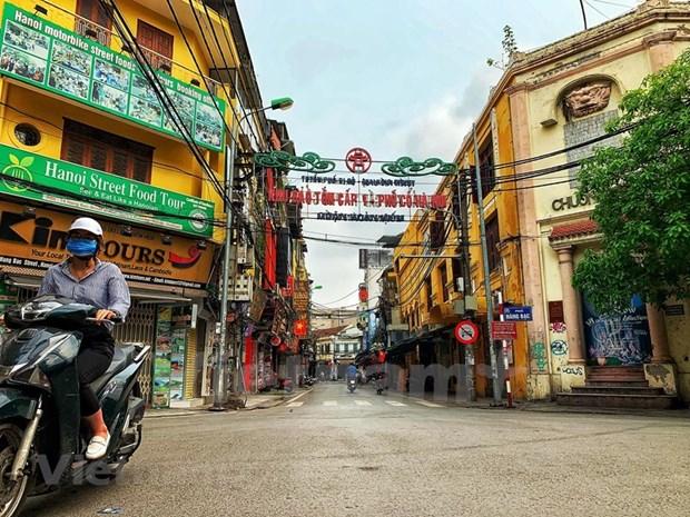 [Foto] Cierran iconicos sitios turisticos de Hanoi por COVID-19 hinh anh 10