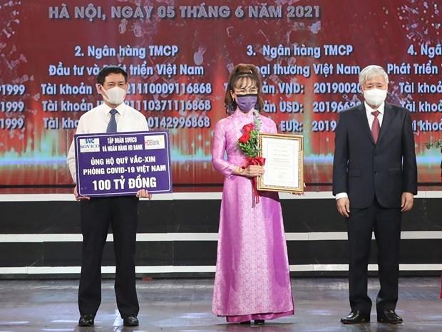 Vietnamitas se unen en lucha contra el COVID-19 hinh anh 2