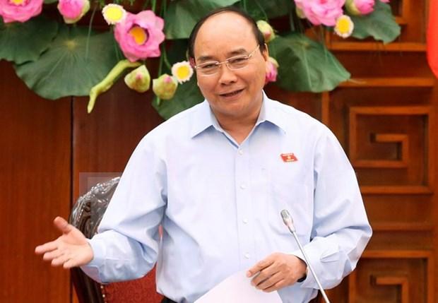 Premier de Vietnam viaja a Camboya para Cumbre de Triangulo de Desarrollo CLV hinh anh 1
