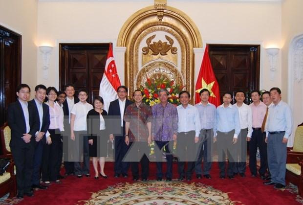 Efectuan decima consulta politica entre cancilleres de Vietnam y Singapur hinh anh 1
