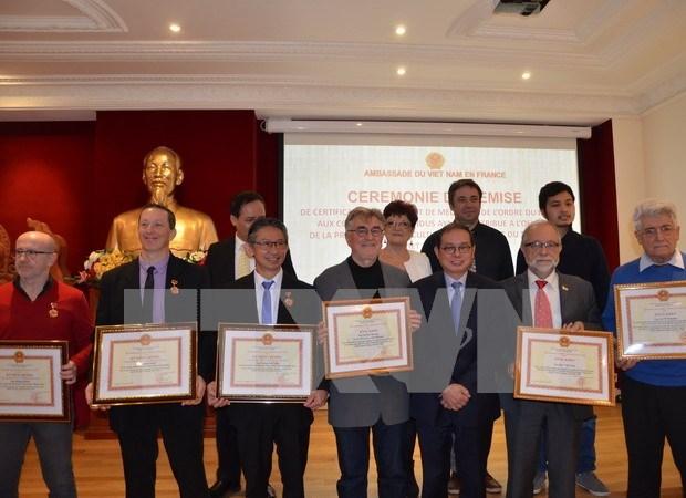 Honran a vietnamitas residentes en Francia por sus contribuciones a nexos bilaterales hinh anh 1