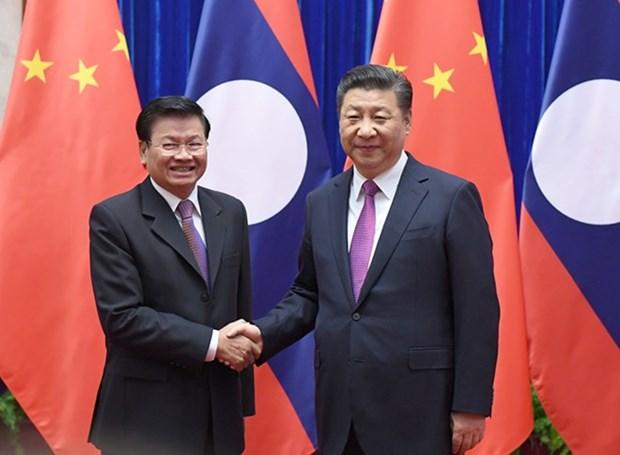 China aspira reforzar relaciones de asociacion con Laos hinh anh 1