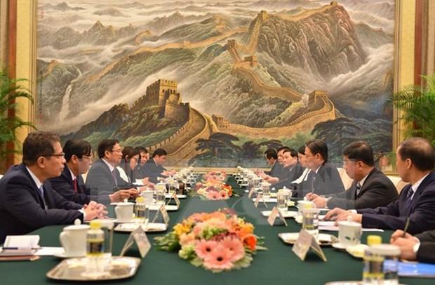 Vietnam confirma politica coherente de fomentar nexos con China hinh anh 1