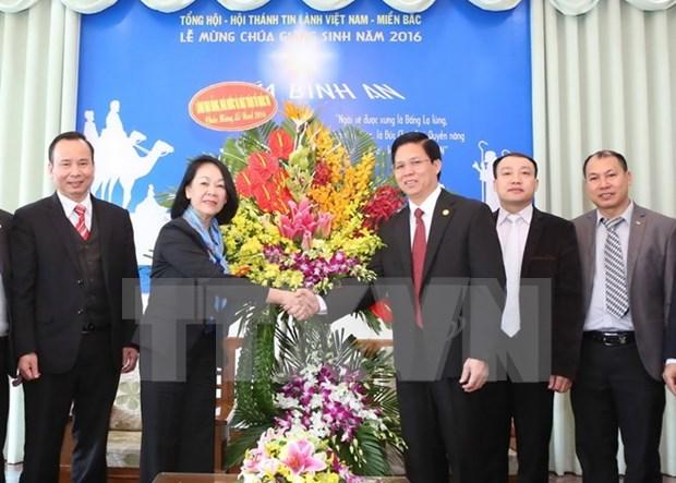 Funcionaria partidista felicita a comunidad religiosa por Navidad hinh anh 1