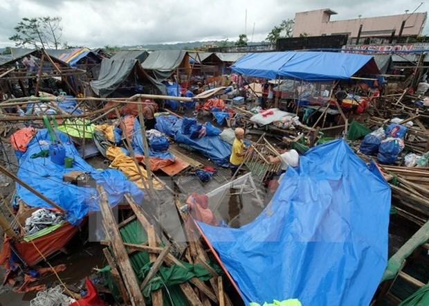 Al menos tres muertos en Filipinas tras paso de tifon Nock-Ten hinh anh 1