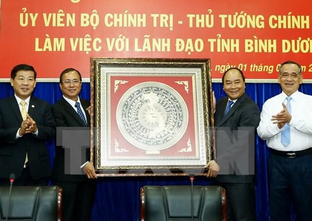 Premier urge a Binh Duong a convertirse en pionero de economia nacional hinh anh 1