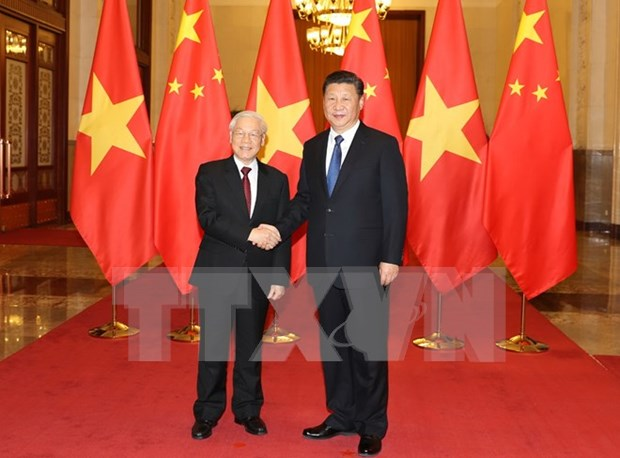 Vietnam y China firman 15 acuerdos de cooperacion en diversas areas hinh anh 1