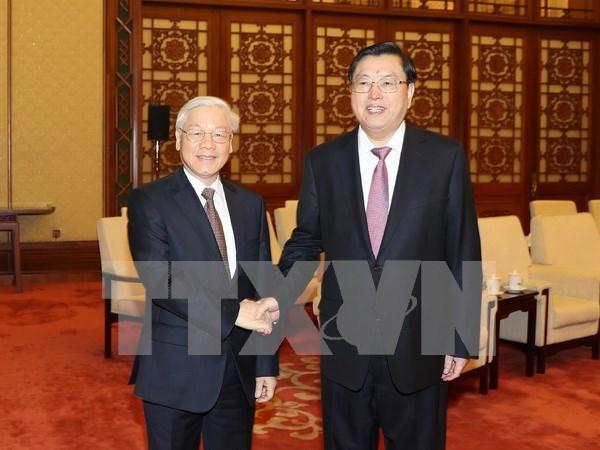 Lider partidista de Vietnam se reune con titular de la Asamblea Popular Nacional de China hinh anh 1