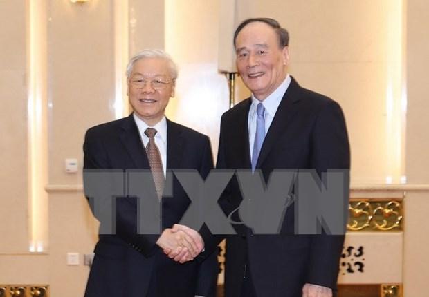 Vietnam y China intercambian experiencias en reforzamiento partidista hinh anh 1