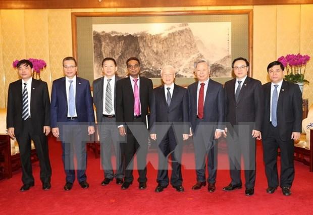 Lider partidista vietnamita recibe a dirigentes de AIIB y de grupo Sunwah hinh anh 1