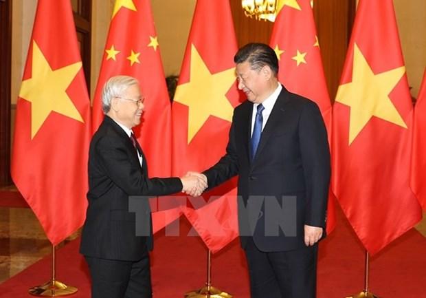 Lideres de Vietnam y China intercambian mensajes por aniversario de lazos hinh anh 1