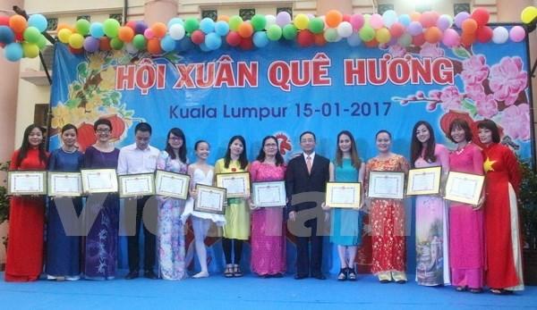 Vietnamitas en ultramar festejan el Tet hinh anh 1