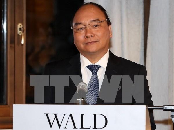 Premier de Vietnam continua actividades en Foro Economico Mundial hinh anh 1