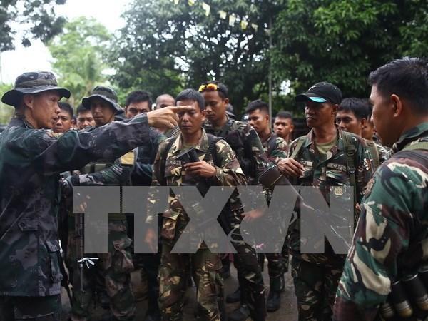 Gobierno filipino y grupo rebelde reanudan negociaciones hinh anh 1
