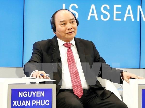Exitosa participacion del premier de Vietnam en Foro de Davos 2017 hinh anh 1