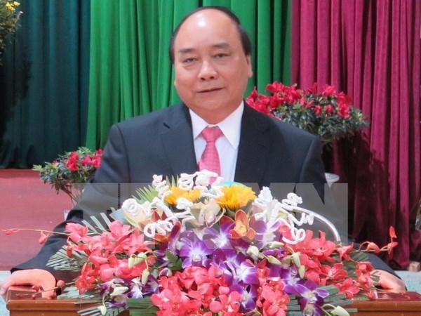 Premier vietnamita insta a Da Nang a acoger con exito Cumbre de APEC hinh anh 1