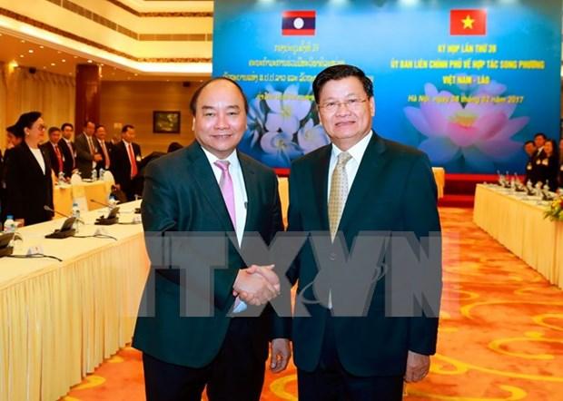 Premier laosiano concluye con exito visita en Vietnam hinh anh 1